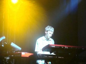Peter Marchant on stage with many keyboards